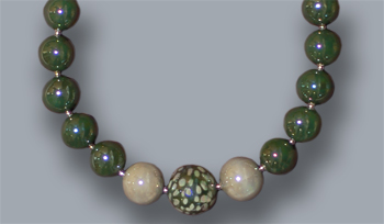 Graduated dark green, light grey, fancy bead; 20 inches long